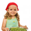 Little girl with lots of peas — Stock Photo #6411129