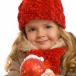 Royalty-Free Stock Photo: Little girl with warm clothes holding christmas ball