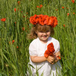 Little girl on wheat field with poppies — Stock Photo