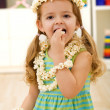 Happy girl eating popcorn - closeup - Stock Photo