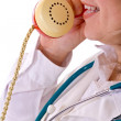 Stock Photo: Female doctor on the phone - closeup