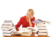 Woman studiyng with lots of books — Stock Photo
