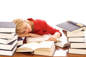 Woman asleep on books — Stock Photo