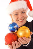 Woman with christmas baubles — Stock Photo