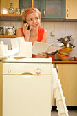 Woman chatting about her new dishwasher — Stock Photo