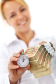 Woman with euro stacks and stopwatch — Stock Photo