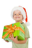 Happy smiling boy with christmas present — Stok fotoğraf