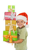 Happy boy at christmas with lots of presents — Stok fotoğraf