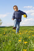 Happy spring dancing child — Stock Photo