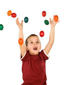 Little boy with falling easter eggs - isolated — Stock Photo