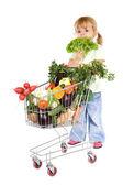 Little girl shopping vegetables — Stock Photo
