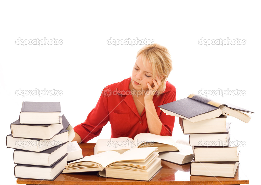 Woman at a desk studying with lots of large books - isolated — Stock Photo #6410318