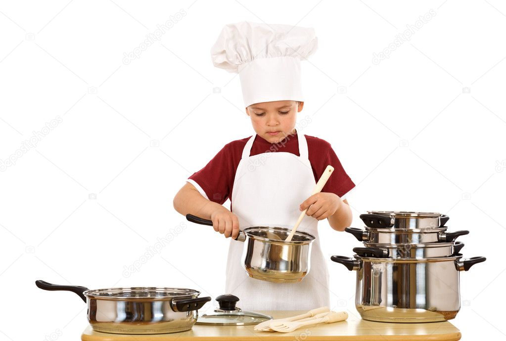 Serious kid chef checking the food - isolated — Stock Photo #6410498