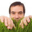 Happy man in green grass - isolated — Stock Photo