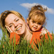 Woman and little girl in the grass - Stock Photo