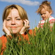 Woman and little girl outdoors — Stock Photo