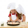 Woman and little girl making pizza — Stock Photo #6430508