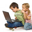 Stock Photo: Children rival for using laptop