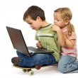 Children rival for using the laptop - Stock Photo