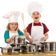 Happy kids dressed as chefs making noise — Stock Photo