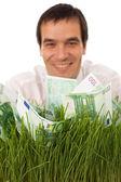 Çim yeşil banknot ile işadamı — Stok fotoğraf