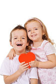 Happy kids with red heart — Photo