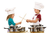 Chefs dual with wooden utensils — Stock Photo