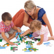 Family playing with puzzle - Stock Photo