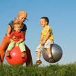 Family jumping on grass — Stock Photo