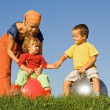 Family outdoors playing together — Stock Photo