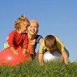 Family playing outdoors — Stock Photo