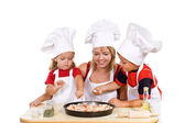 Kids and their mother preparing a pizza — Stock Photo