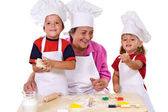 Grandmother with kids making cookies — Stock Photo