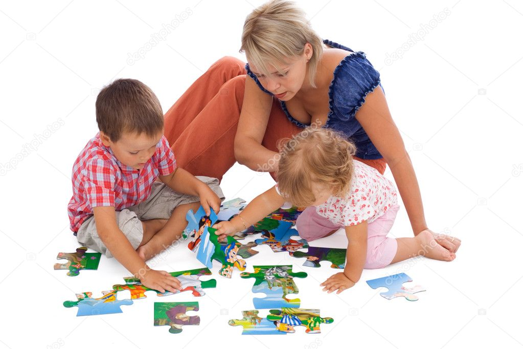 Family, woman and kids, playing with puzzle on the floor - isolated  Stock Photo #6441366