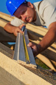 Builder carpenter measuring wood planck — Stock Photo