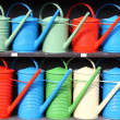 Colorful watering cans — Stock Photo #6295285