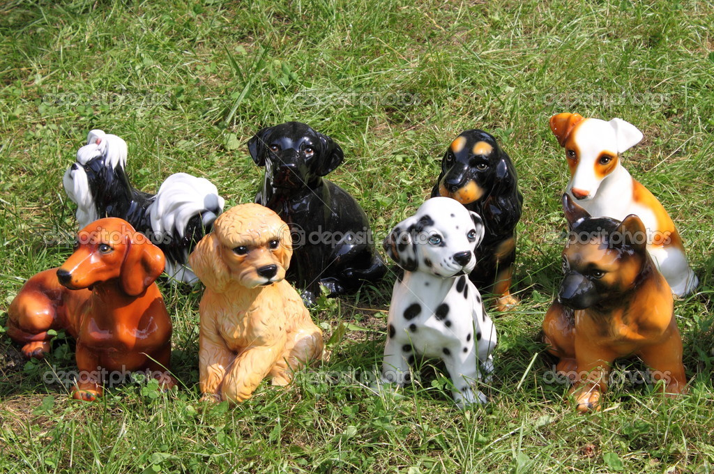 Dog breed statues on a grass background — Stock Photo #6472183