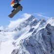 Snowboarder in high mountains — Stock Photo