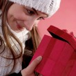 Girl looking into gift — Stock Photo