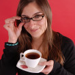 Girl smiling holding tea and glasses — Stock Photo #6292012