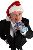Business Santa noise maker — Stock Photo