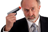 Businessman dart gun — Stock Photo