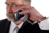 Cuffed to phone — Stock Photo