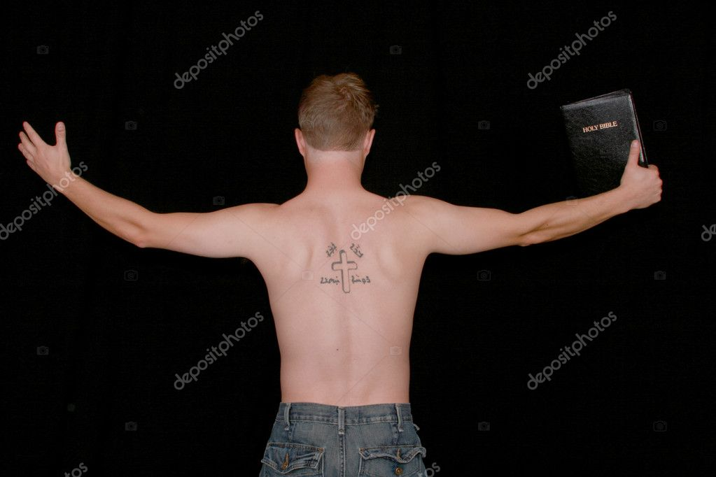 A man preaching with a crucifix and Aramiac writing tattooed on his back. — Stock Photo #6291919