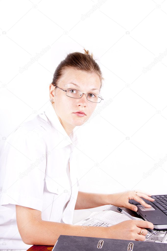 The beautiful girl works at the computer isolated   Stock Photo #6308758
