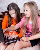 Children play at the computer — Stock Photo