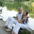 Two girls play at the lake - Foto de Stock  
