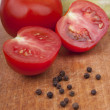 Tomatoes with fragrant pepper close up — Stock Photo