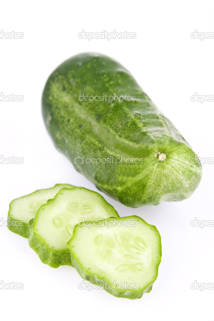 Green cucumber slice, isolated on a white background — Stock Photo #6631892