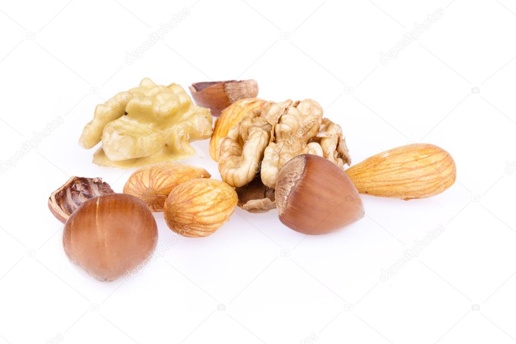 Walnuts, hazelnuts and almonds isolated on a white background — Stock Photo #6631900